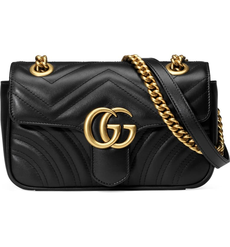 Black Gucci Mini Bag with gold strap. Luxury gift ideas.