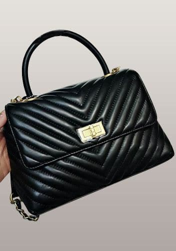 Black chanel dupes bag with handle.