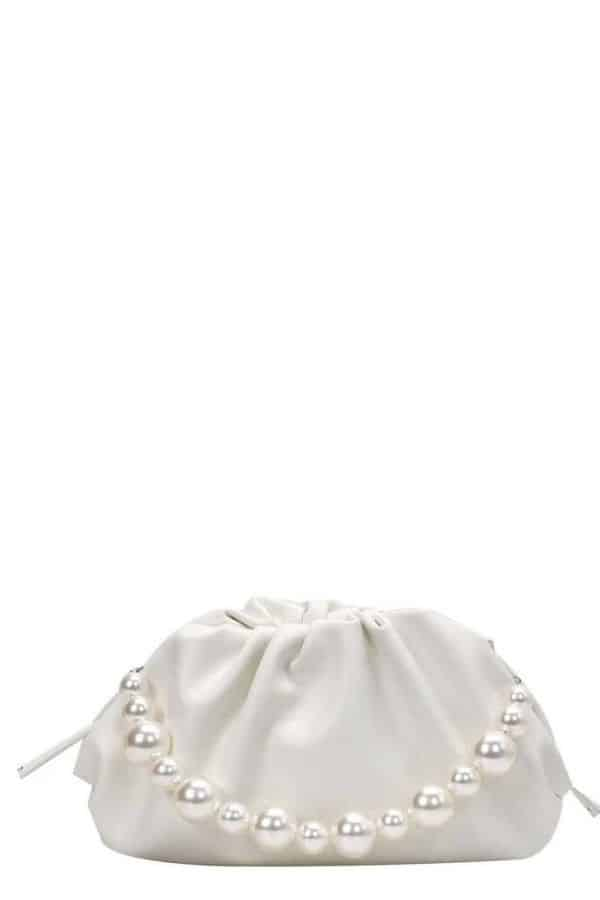 White bottega pouch dupe with pearl handle.