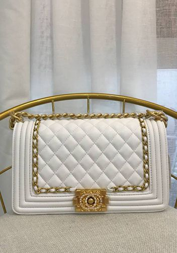 White and Gold quilted chanel boy bag dupe.