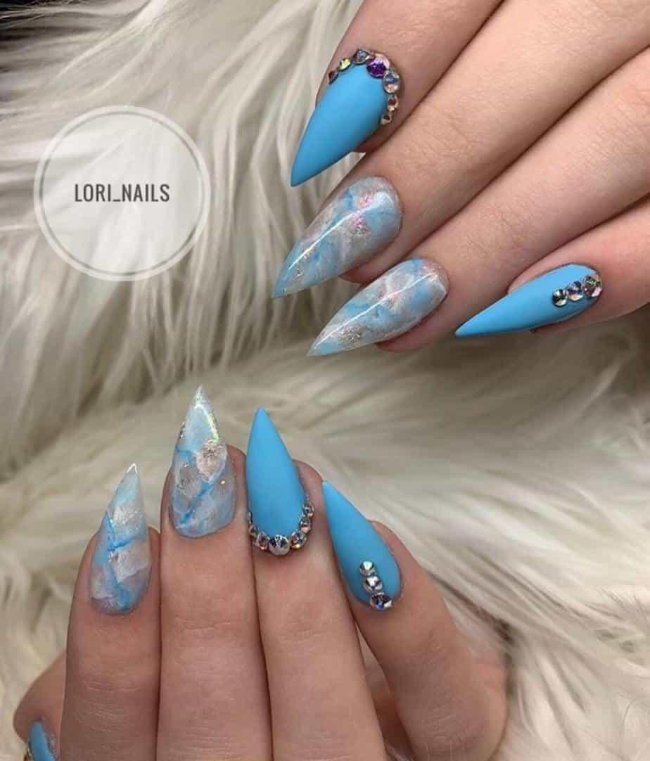 Blue pretty nails designs with rhinestones .