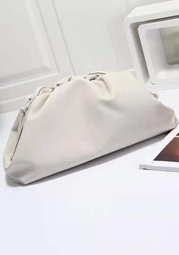 White dumpling bag dupe for Bottega Veneta look-alike clutch.