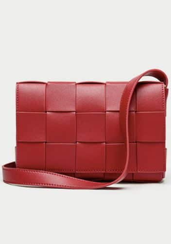 Red bottega veneta cassette bag dupe in bottega inspired bag.