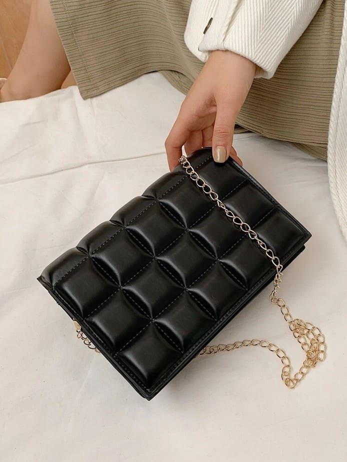 Black bottega veneta purse dupe.