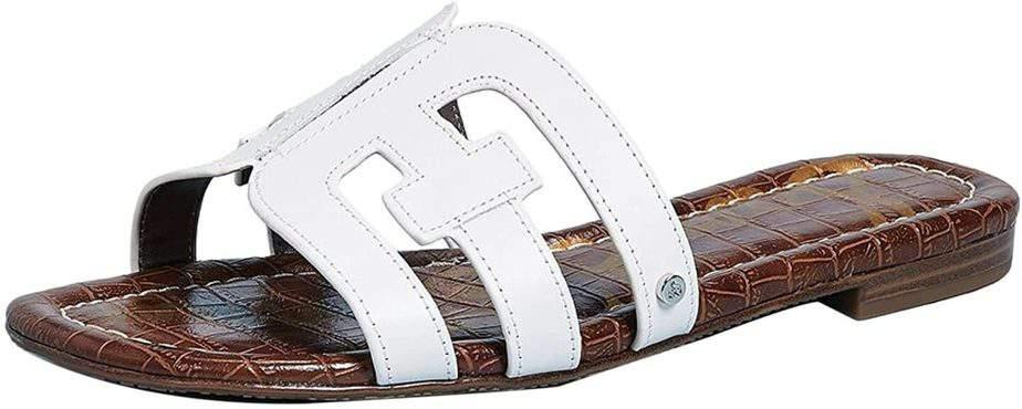 White hermes slippers.